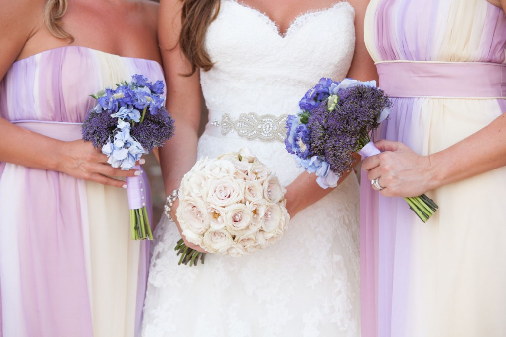 bridesmaids with pastel dresses and purple flowers