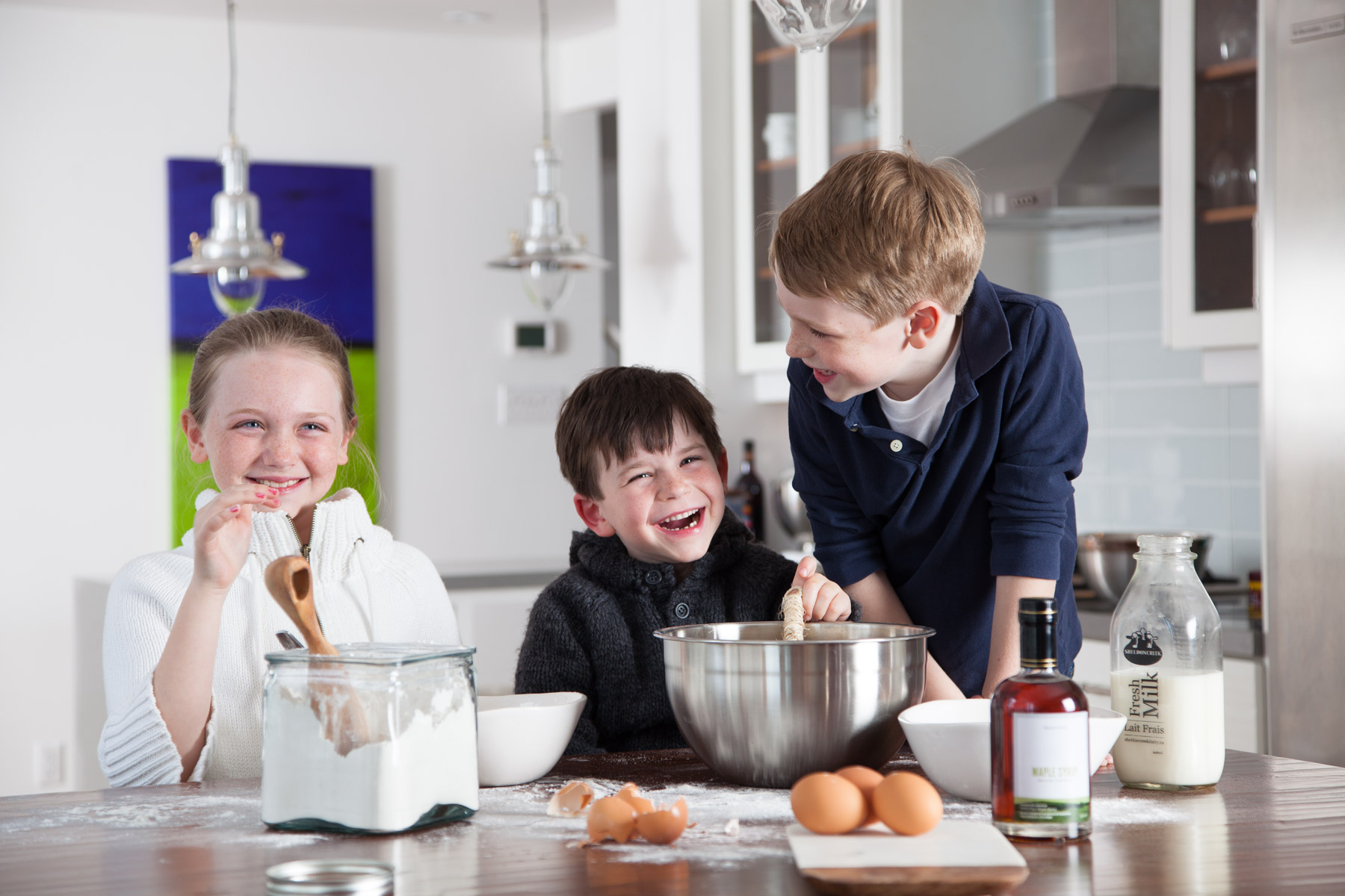 creative direction lifestyle brand photography. Three kids making pancakes.