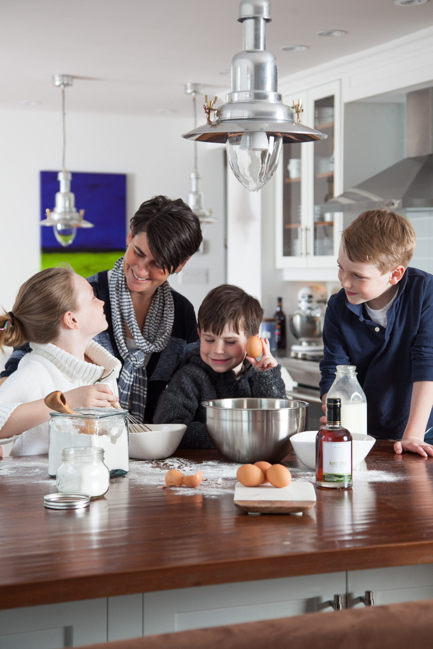 how to use Pancake Tuesday national holiday in your content marketing. Family making pancakes, smiling, and having fun.